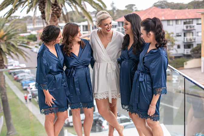 Bride with bridesmaids all in their dressing gowns. Wedding photography by best sydney wedding photographer, Grant Hoskinson Photography.