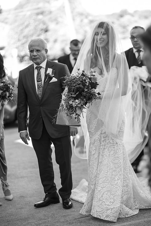 Bride and father of the bride about to enter the church for the wedding ceremony. St Mary and St Merkorious Coptic Orthodox church. Photography by best Sydney wedding photographer Grant Hoskinson Photography.