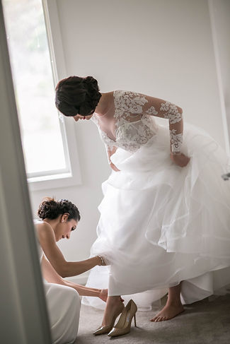 Bride getting ready. Putting on the shoes. Wedding photgraphy by Sydney wedding photographer Grant Hoskinson Photography.