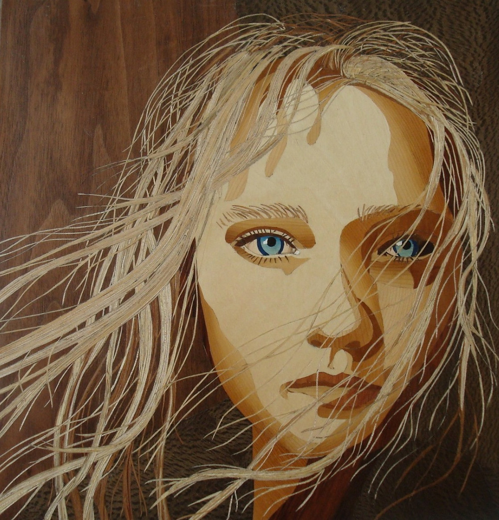 Face of a girl in marquetry