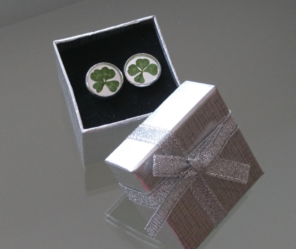 Silver earrings with very small four leaf clover.