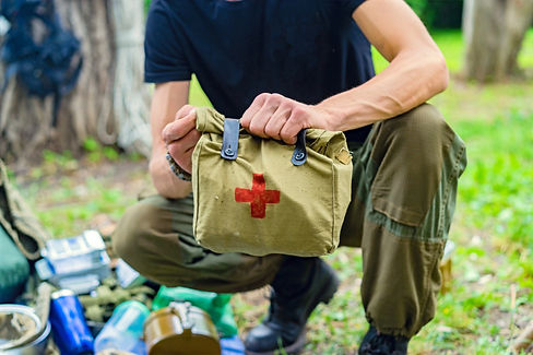 male holding first aid prepper kit.jpg