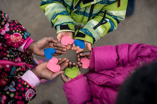 children-holding-hearts-in-hands-P38UMNK