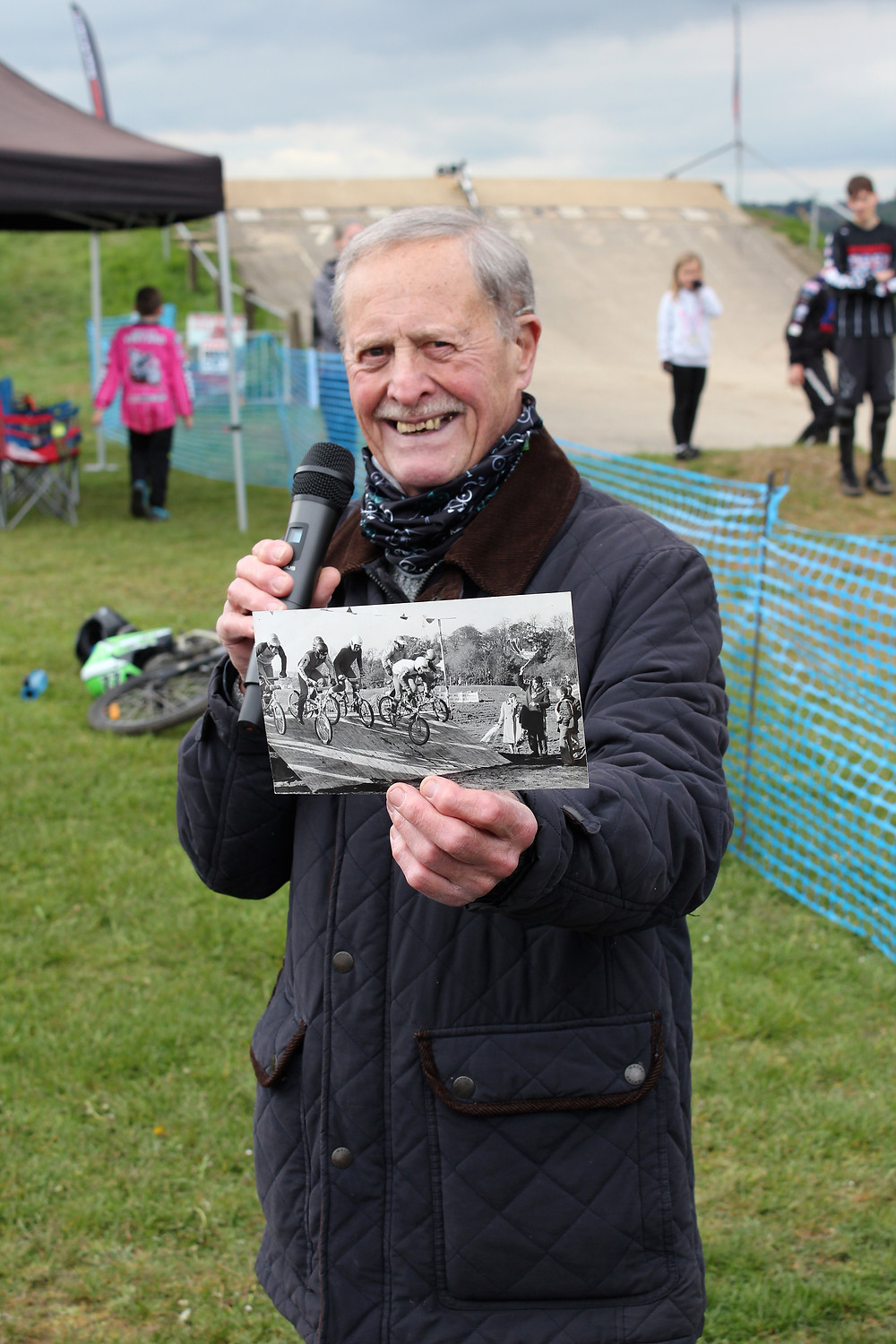 One of the club's founders with a photo of the first race at Landseer Park in November 1980.