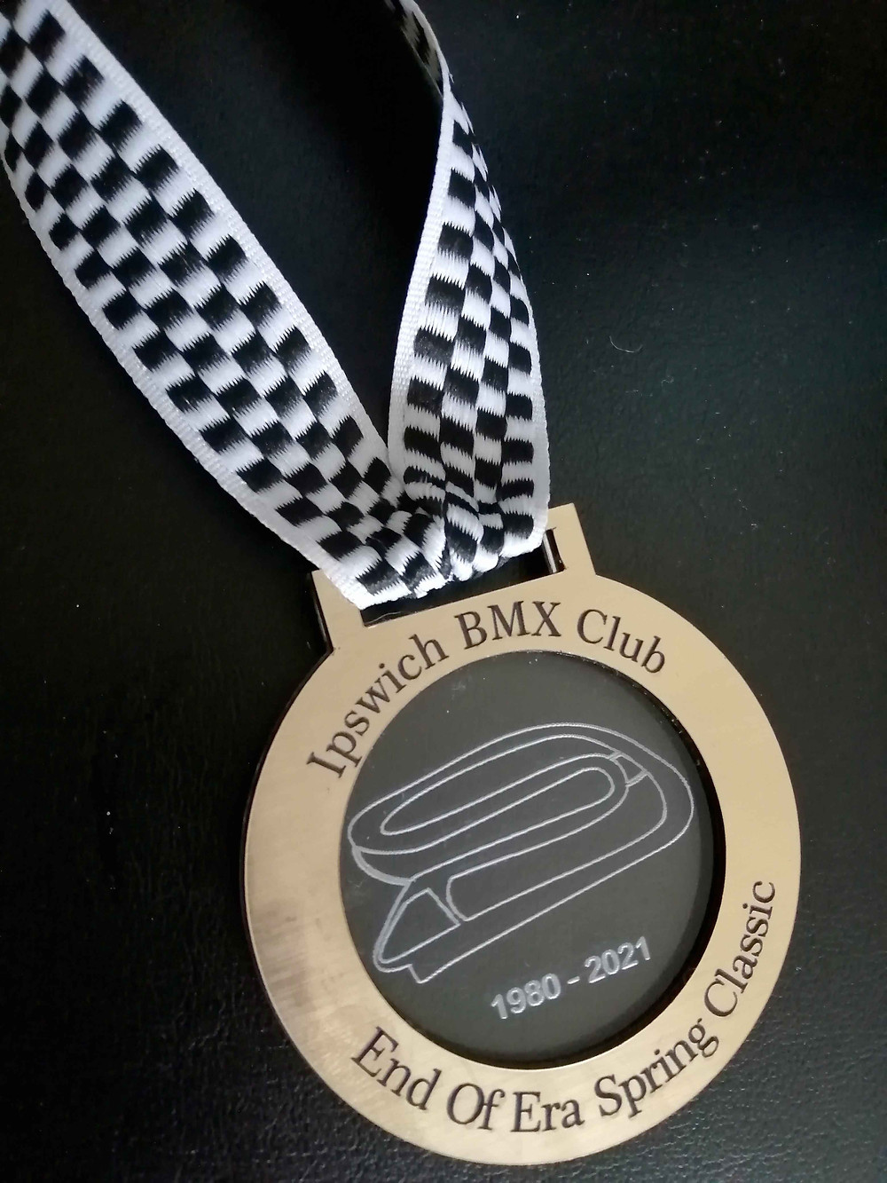 Medal with imagery of our existing track.