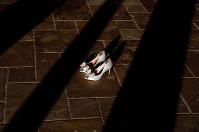 Amazing Wedding shoes and light coming through the windows in the main room at Swancar Farm Country House in Nottingham