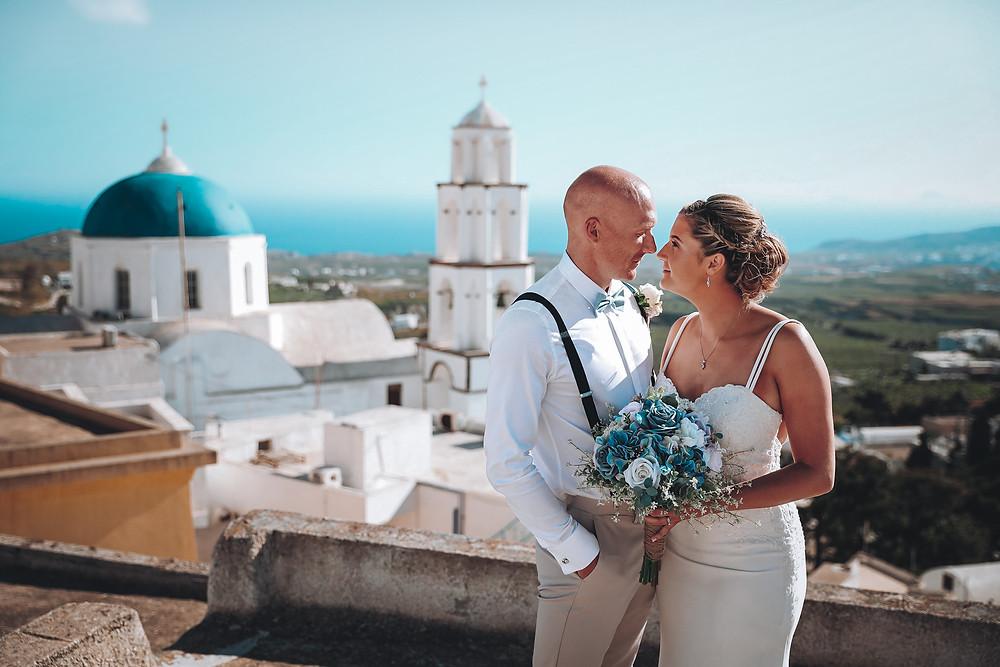 A wedding  Daniel Burton Photography covered with a Derbyshire couple on their destination wedding in Santorini Greece. The rooftops of Pyrgos, Santorini, Greece.