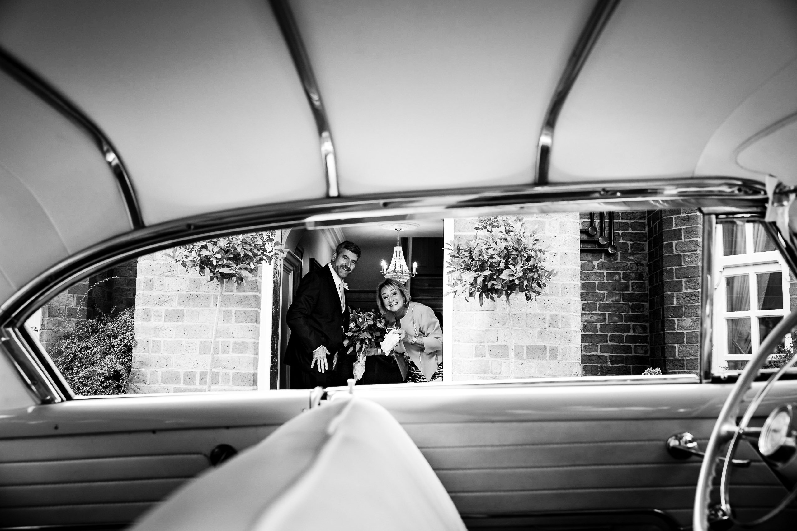 Proud Parents at Swancar Farm Country House just after their daughters arrival in a classic car by Mr Vintage Car.