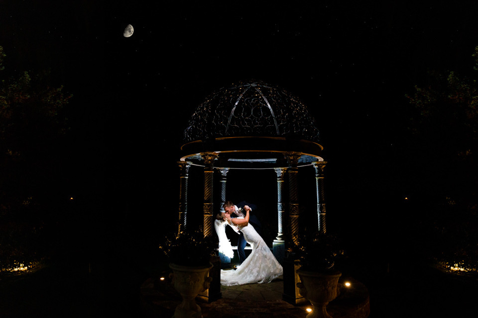Photo of a bride and groom dancing in a pergola at night at the fabulous https://www.swancarfarmcountryhouse.com/