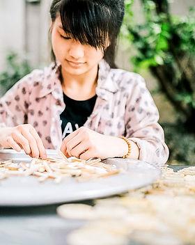 woman making calypso earrings.jpg