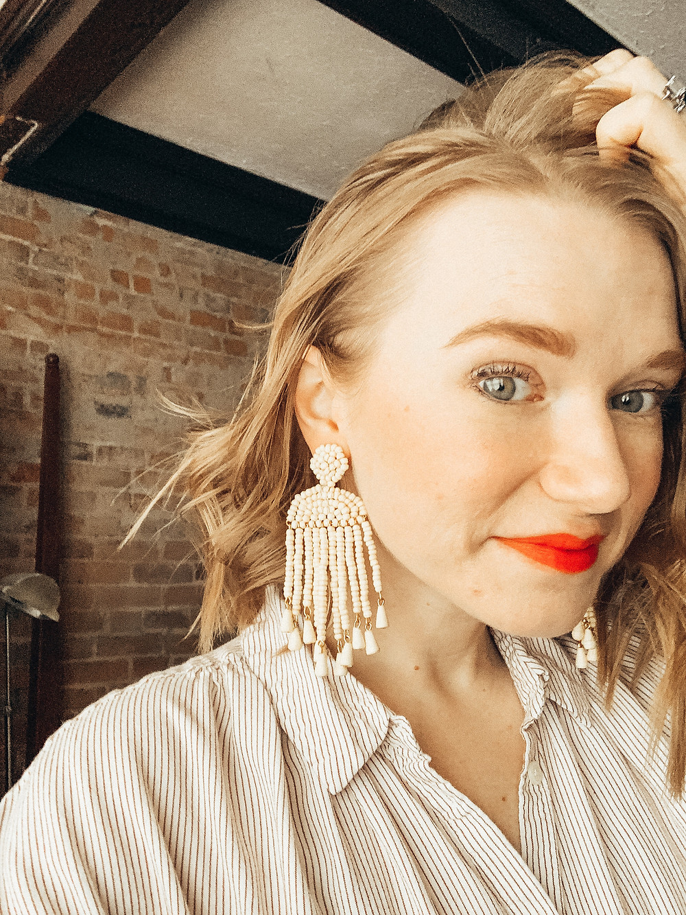Lauren in the Afiswa Earrings with a bright lip