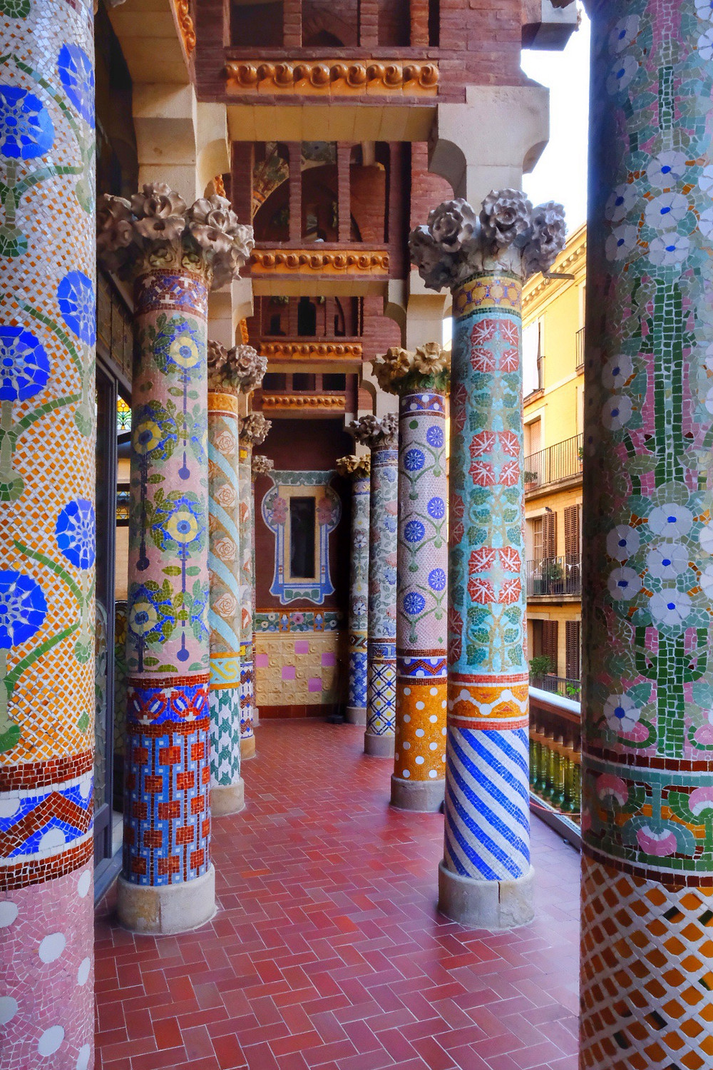 Detailed tile mosaic pillars dominate the space with art and colour