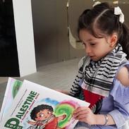 kuwait_palestine_book_customer_reading3.jpg