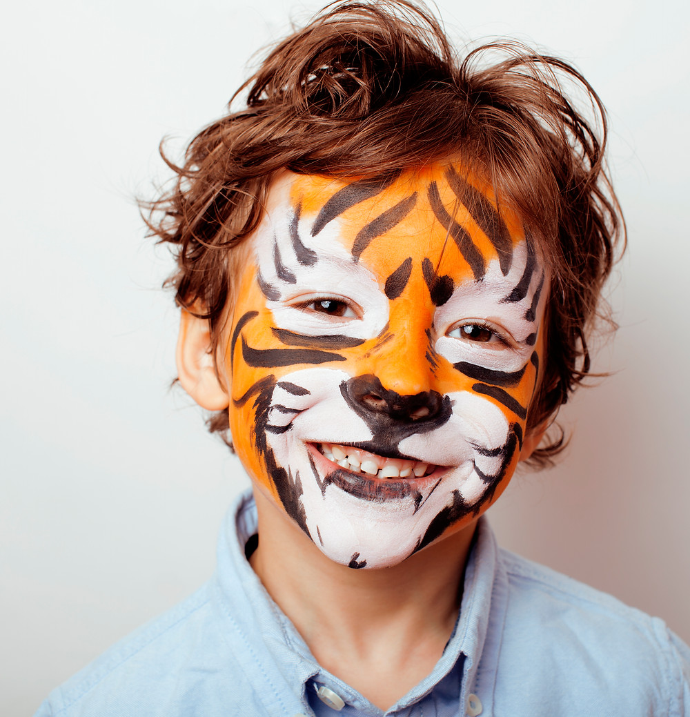 Tiger Face Painting - image via iStock