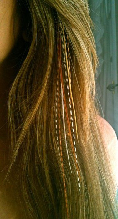 Feather Hair Extensions - image via Pinterest