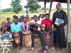 Fr. Mark with the choir members.jpg