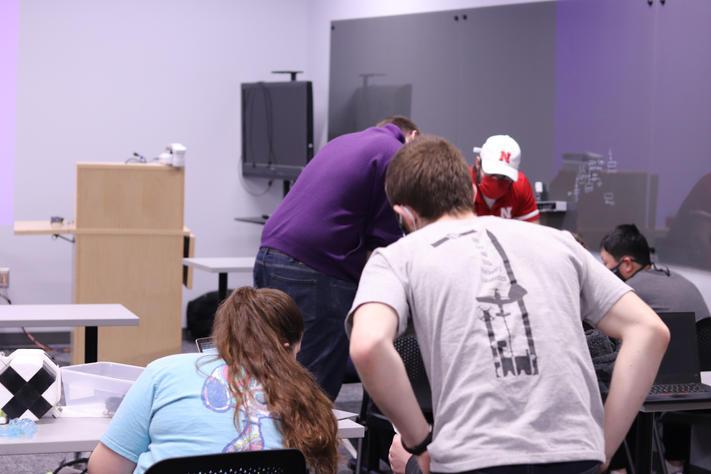 Kaycee and John looking over Payload Pi's light sensor