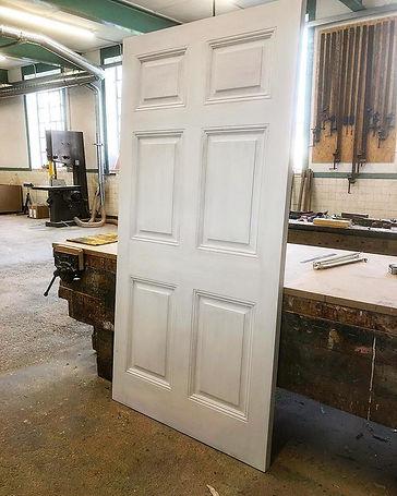 Hardwood Georgian six panel front door .