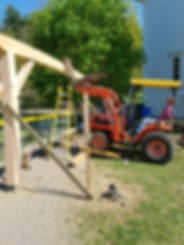 tractor raising timber frame handmade scribe frame structural wood