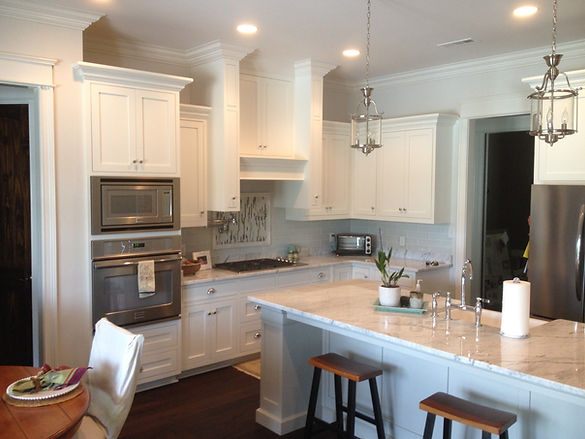 White kitchen cabinets above the oven and stove