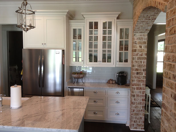 Kitchen cabinets above and beside the refrigerator