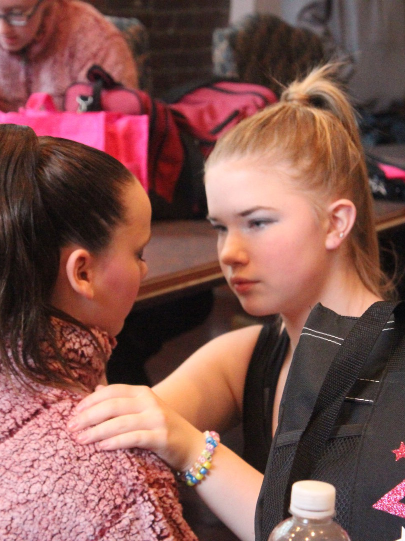 One of our older girls helping a younger one with makeup!