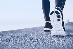 Integrative-Therapy-Restore-Dry-Needling-A-view-of-a-runner's-sneaker-sole-as-they-run