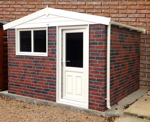 Apex brick concrete shed with UPVC windows and door