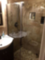 Remodeled bathroom with custom tilework
