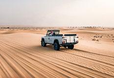 Land Rover in Desert of Dubai.jpg