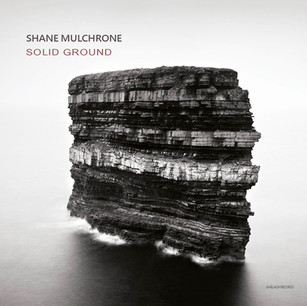 Solid Ground by Shane Mulchrone