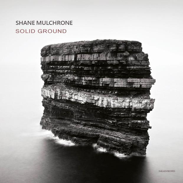 Solid Ground by Shane Mulchrone