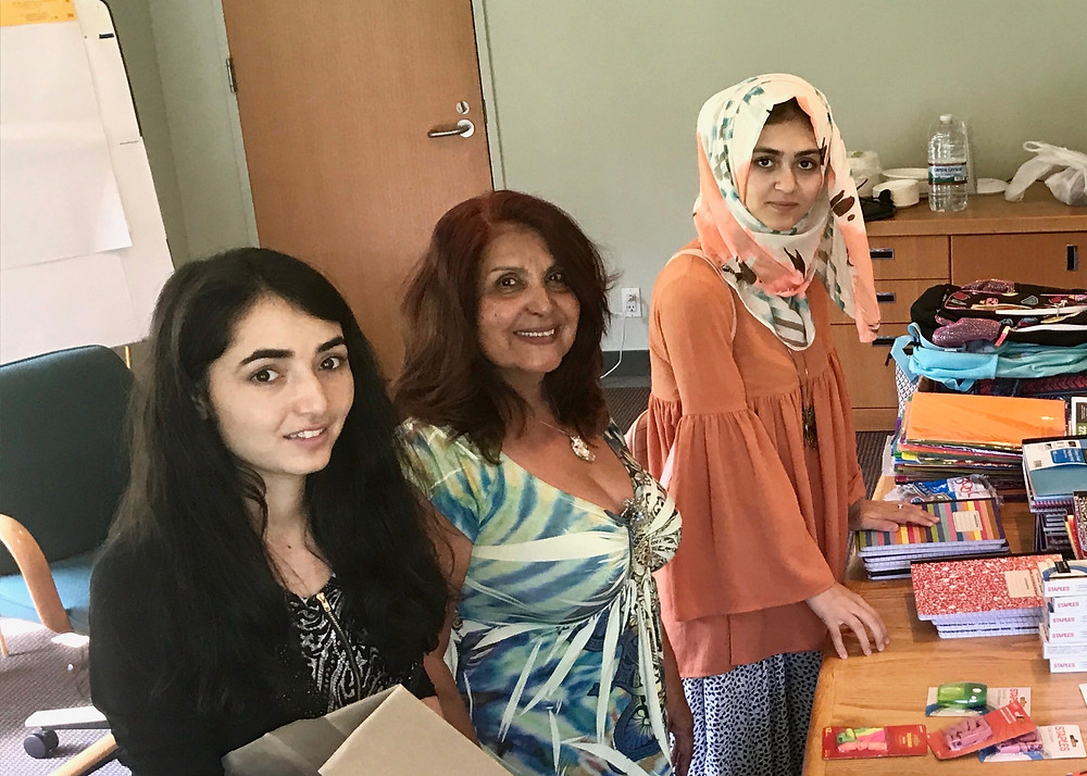 Sapida Barmaki (Montclair State 2019), Latifa Woodhouse, Board of Directors, and Shahrzad Koofi Ahmadi (Montclair State 2021) prepare school supplies for the Social Justice Committee at the Unitarian Universalist Congregation at Shelter Rock