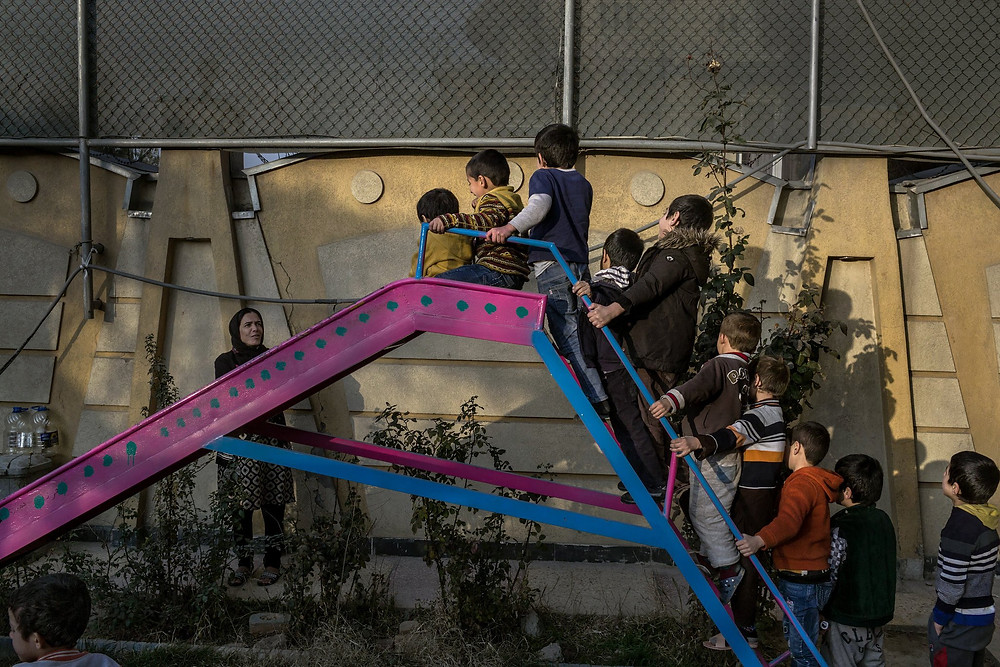 Playtime at the Children's Support Center in Kabul, an orphanage-like facility for children whose mothers are in prison, and that is in danger of losing its funding. Mauricio Lima for The New York Times
