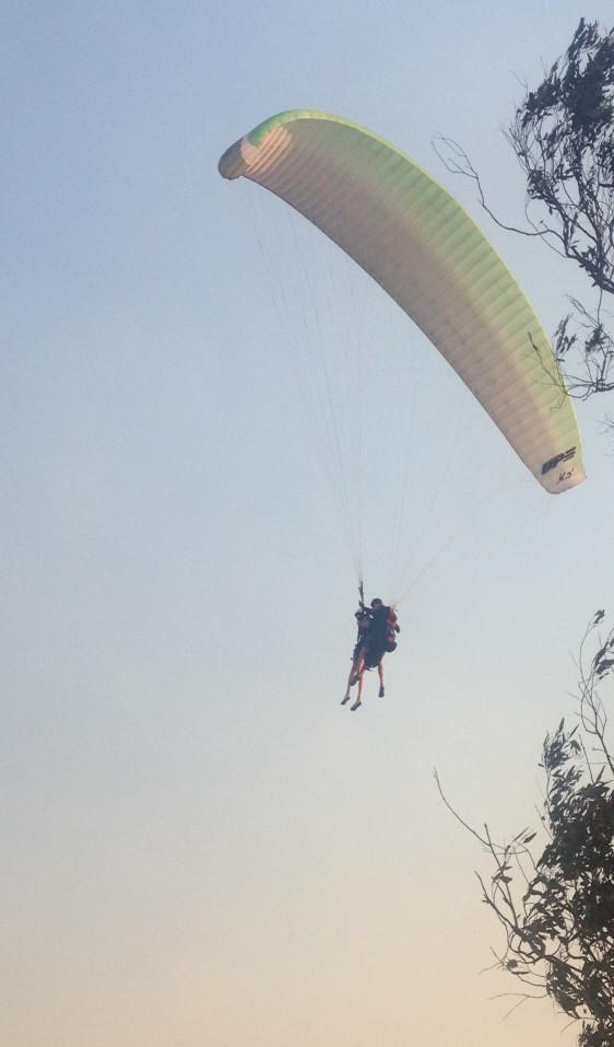 Tandem Paraglider landing backwards in strong wind
