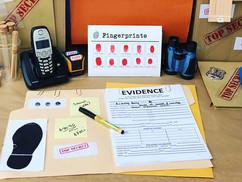 Case file 📋on detective's desk🗂📦🗃🗂☎