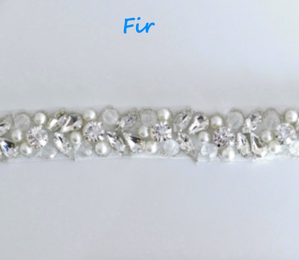 "This trim has it all, high-grade white/light ivory pearls, glinting crystals and transparent beading, all surrounded by silver threadwork. 2cm (3/4"")"