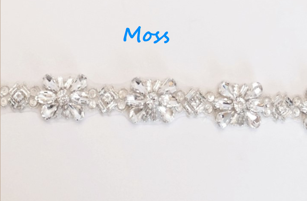"""Outlined with silver thread and containing finest crystals, this flexible, feminine trim is 2.5cm (1"""") wide"""