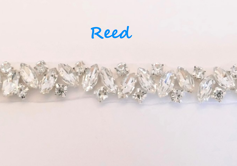 "A simple elegant trim of cat's eye crystals and rhinestone 1cm (1/2"")"