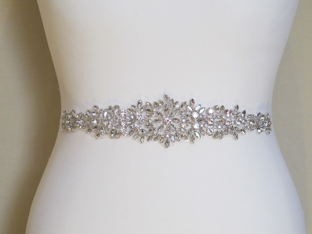 "Clear bright crystals of all sizes and shapes. 28cm x 5cm (tapering to 1.9cm) 11"" x 2"""