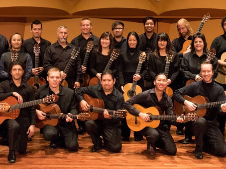 Why a guitar orchestra?                             by David Grimes