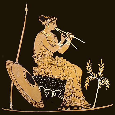 Ceramica apula a figure rosse. Suonatrice di doppio flauto.