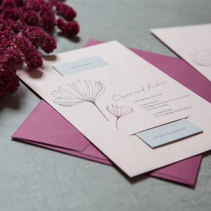 Purple wedding invitation with ginkgo leaf