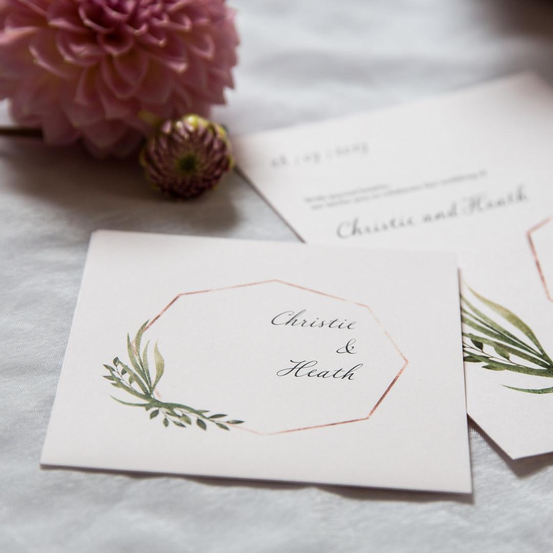 Green leaf and octagon wedding invitation