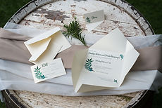Origami hand folded wedding invitations and rsvp card with a green foliage leaf design
