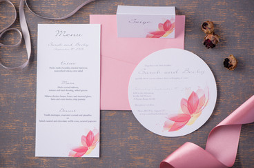 Pink delicate round wedding invitation and matching menu and place card