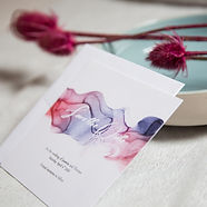 Pink purple and blue watercolour ink swirl design on unique save the date cards with a white envelope