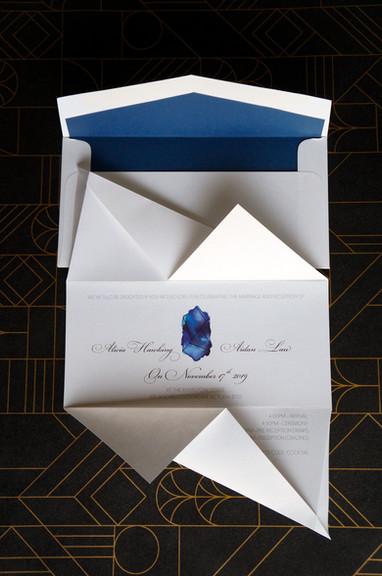 Blue origami wedding invitation