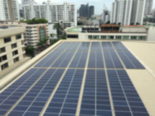 Solar panels on the rooftop of office bu