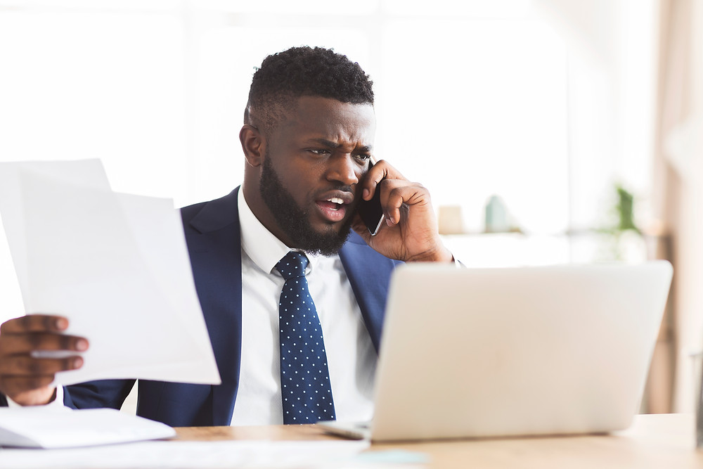 Businessman on the phone attempting to overcome field service miscommunication